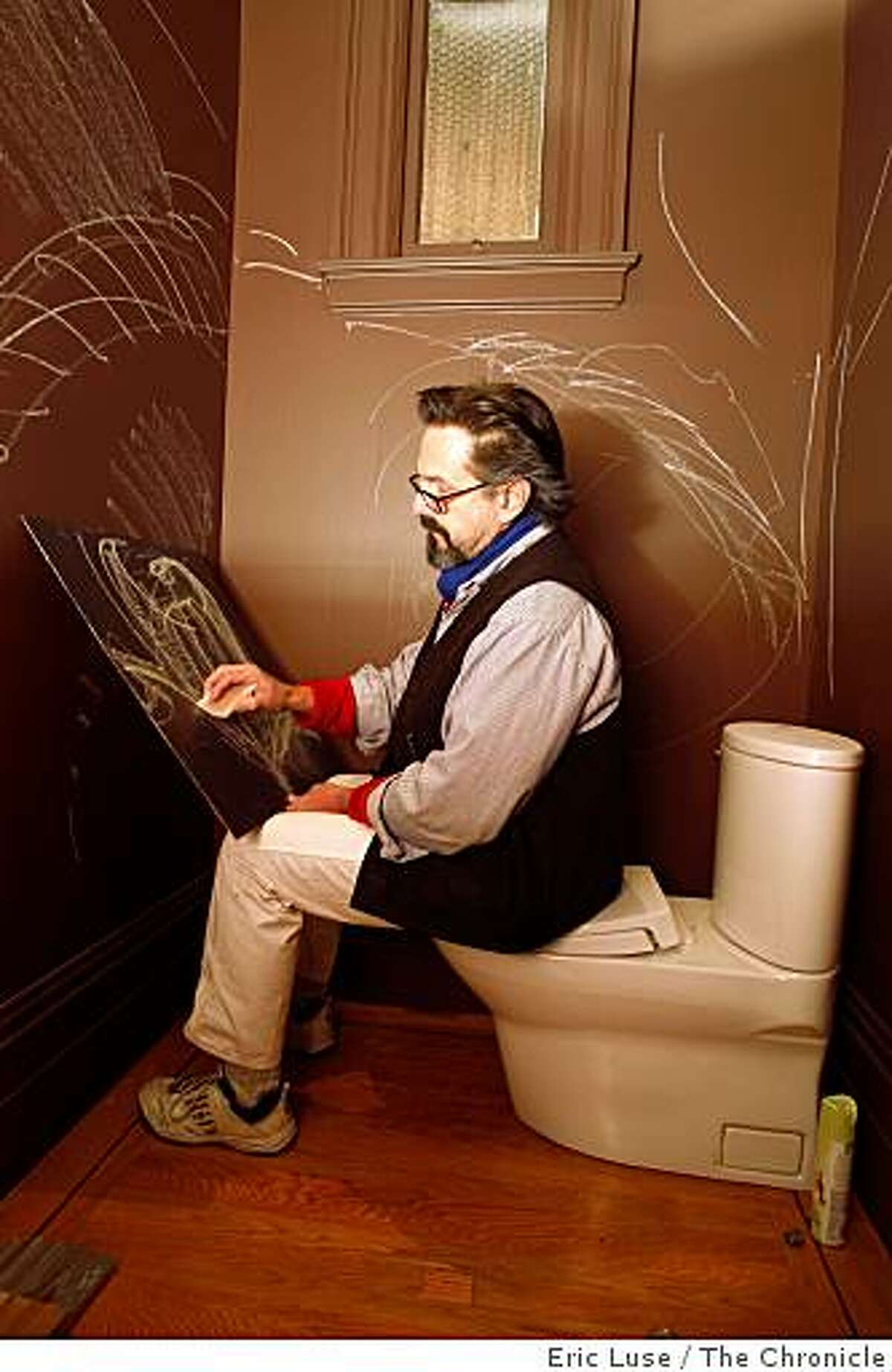 Master Painter Ted Somogyi forgot his chock but used a piece of sheetrock to sketch out an idea of what to do with Anastasia Faiella's tiny bathroom. This is going through a make over at the 2009 Decorator Showcase photographed in San Francisco on Wednesday, March 11, 2009.