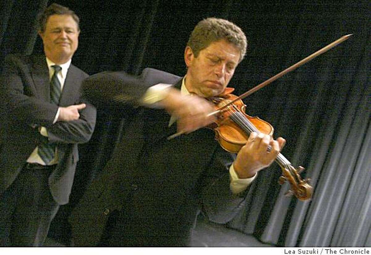 The SF Symphony and Fine Arts Museum have worked out a deal whereby Jascha Heifetz's rare Guarneri violin, which usually spends its life in a museum case, will be played regularly at Symphony concerts by concert master Alexander Barantshick. Photo By Lea Suzuki/San Francisco Chronicle