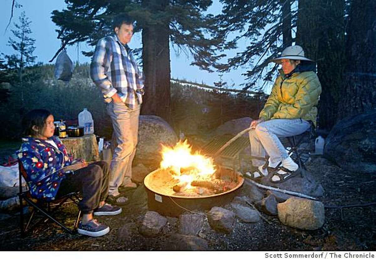 Sumana Meissner tells ghost stories to daughter, Sidara, and husband, Oliver, at camp near Carr and Feeley lakes in Nevada County.