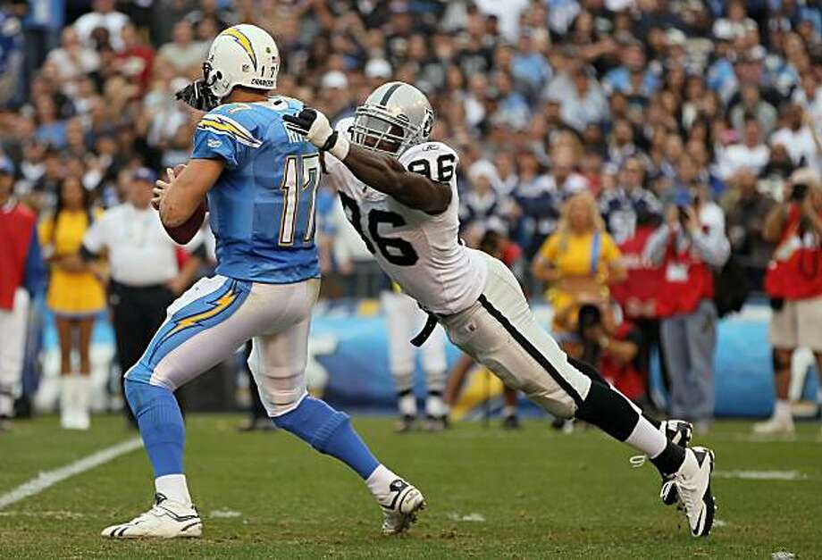 SAN DIEGO - DECEMBER 05:  Quarterback Philip Rivers #17 of the San Diego Chargers is sacked by Kamerion Wimbley #96 of the Oakland Raiders at Qualcomm Stadium on December 5, 2010 in San Diego, California. The Raiders defeated the Chargers 28-13. Photo: Jeff Gross, Getty Images