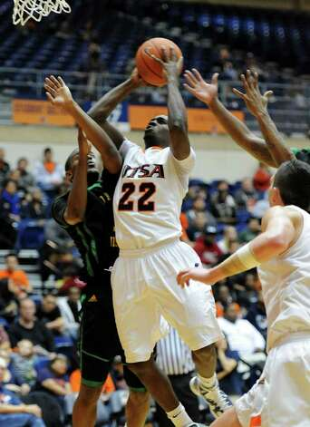 UTSA junior Kannon Burrage (22) is fouled while taking a shot during a Southland Conference mens  basketball game between UTSA and Southeastern Louisiana at the UTSA Convocation Center In San Antonio, Texas on February 8, 2012. John Albright / Special to the Express-News. Photo: Express-News