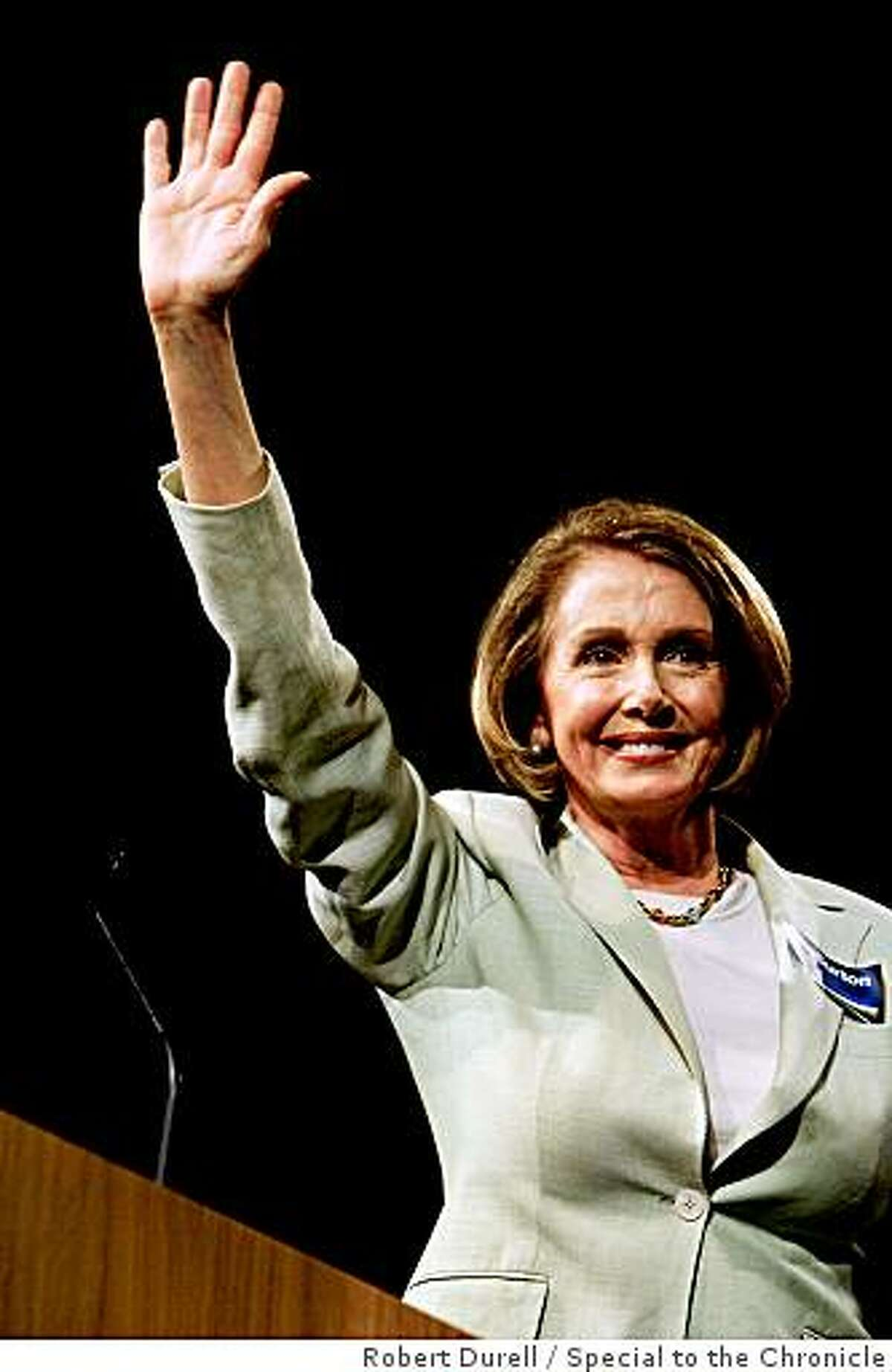 Nancy Pelosi (D-California), Speaker of the House, waves to delegates after addressing the state Democratic Convention in Sacramento, April 25, 2009.