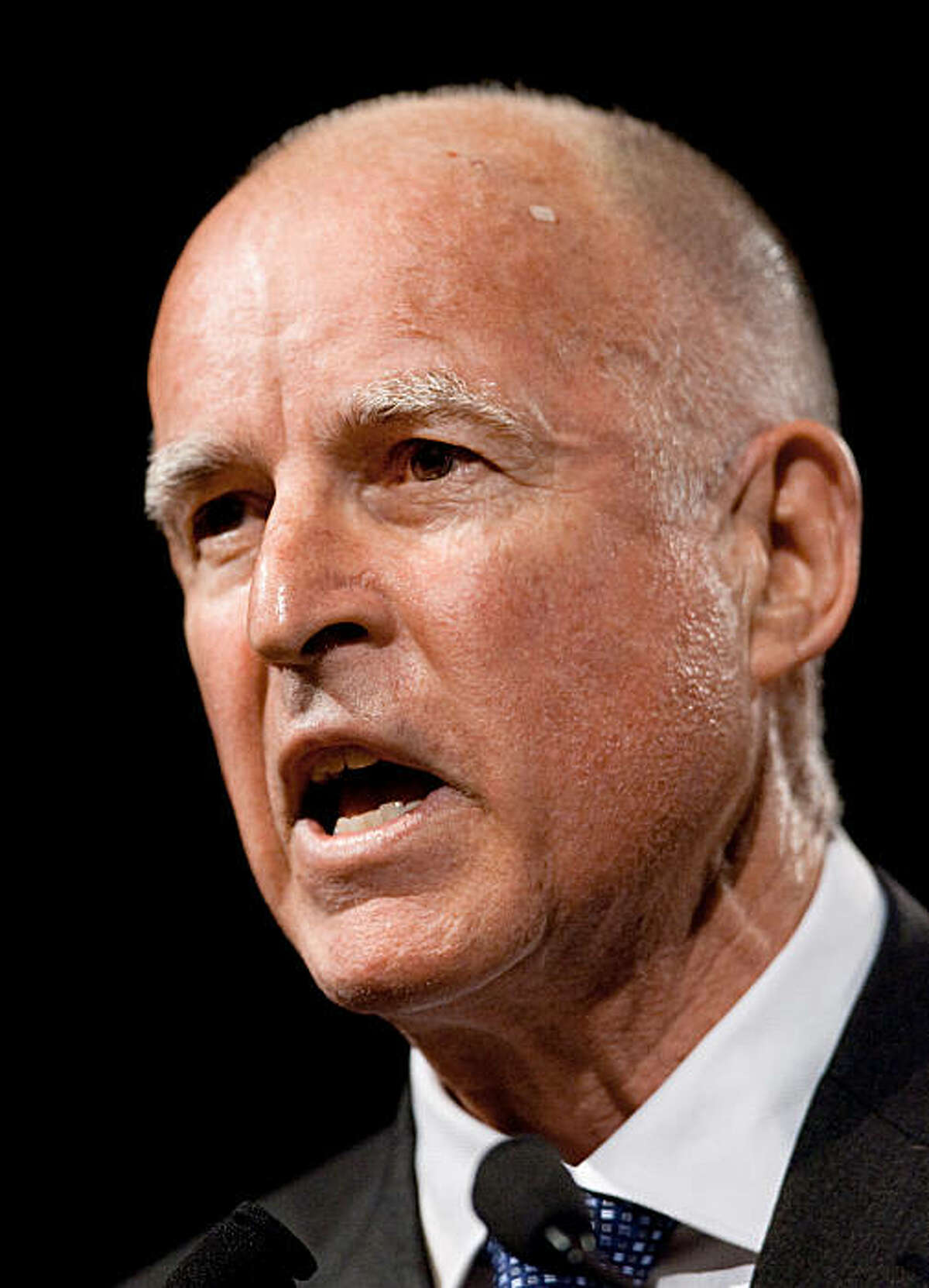 Jerry Brown, state attorney general, speaks to the California Democratic Party state convention in Sacramento, California April 25, 2009. He and San Francisco mayor Gavin Newsom are rivals in the 2010 gubernatorial race. Newsom spoke to the convention earlier.
