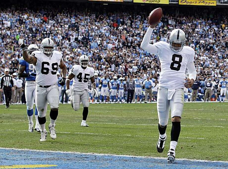 Oakland Raiders quarterback Jason Campbell, right, scores a touchdown in the first quarter against the San Diego Chargers during their NFL football game Sunday, Dec. 5, 2010, in San Diego. Photo: Gregory Bull, AP
