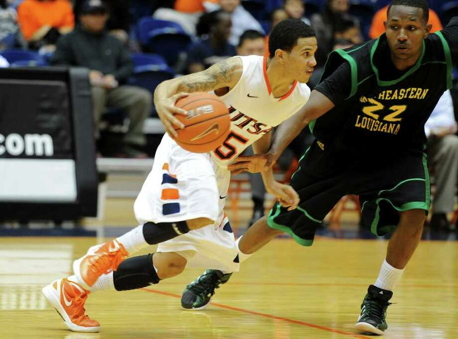 UTSA junior Michael Hale (5) dribbles past a defender during a Southland Conference mens  basketball game between UTSA and Southeastern Louisiana at the UTSA Convocation Center In San Antonio, Texas on February 8, 2012. John Albright / Special to the Express-News. Photo: Express-News