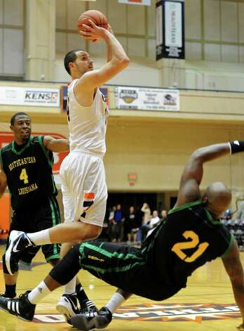 UTSA senior Alex Vouyoukas (14) takes a shot between two defenders during a Southland Conference mens  basketball game between UTSA and Southeastern Louisiana at the UTSA Convocation Center In San Antonio, Texas on February 8, 2012. John Albright / Special to the Express-News. Photo: Express-News