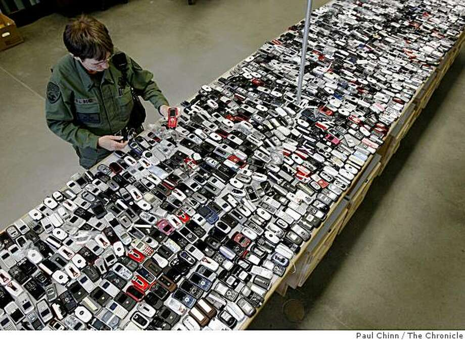 Lt. Robin Bond examines the 1800 cellphones confiscated from prisoners since 2006 at the California State Prison Solano in Vacaville, Calif., on Wednesday, April 29, 2009. Photo: Paul Chinn, The Chronicle