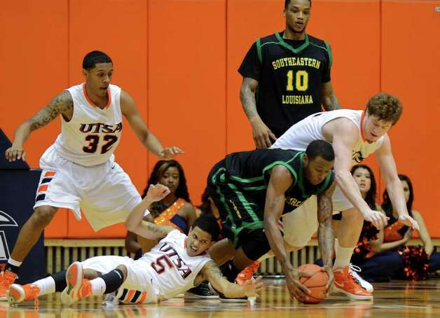 UTSA's Jordan Sims (32), Michael Hale (5) and Tyler Wood (42) battle for a loose ball with Southeastern Louisiana's Donavon Ross (4) during a Southland Conference mens  basketball game between UTSA and Southeastern Louisiana at the UTSA Convocation Center In San Antonio, Texas on February 8, 2012. John Albright / Special to the Express-News. Photo: Express-News