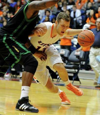 UTSA sophomore Igor Nujic (13) drives to the hoop during a Southland Conference mens  basketball game between UTSA and Southeastern Louisiana at the UTSA Convocation Center In San Antonio, Texas on February 8, 2012. John Albright / Special to the Express-News. Photo: Express-News