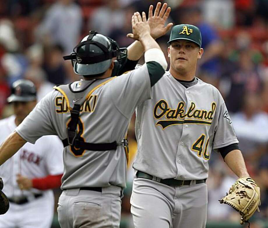 Oakland Athletics catcher Kurt Suzuki, left, and pitcher Andrew Bailey celebrate after the Athletics defeated the Boston Red Sox 9-8 in a baseball game at Boston's Fenway Park, Thursday, June 3, 2010. Photo: Steven Senne, AP