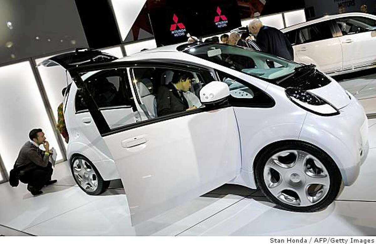 The Mitsubishi Motors iMiEV electric prototype vehicle is inspected by members of the media at the New York International Auto Show April 9, 2009 in New York. AFP PHOTO/Stan Honda (Photo credit should read STAN HONDA/AFP/Getty Images)