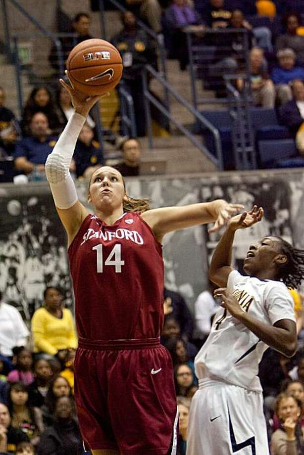 Kayla Pedersen, #14 from Stanford takes a shot as Eliza Pierre of California attempts to defend during the 1st half of the Stanford vs California women's basketball game on January 2, 2011 at Haas Pavilion in Berkeley, Calif.  Photograph by David Paul Morris/Special to the Chronicle Photo: David Paul Morris, Special To The Chronicle