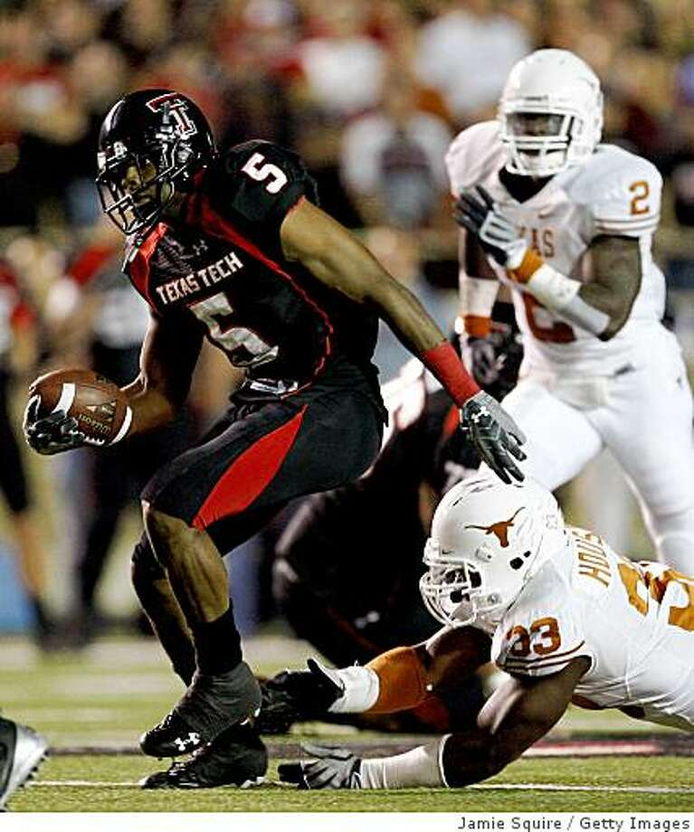 LUBBOCK, TX - NOVEMBER 01:  Michael Crabtree #5 of the Texas Tech Red Raiders carries the ball after making a reception during the first half of the game against the Texas Longhorns on November 1, 2008 at Jones Stadium in Lubbock, Texas.  (Photo by Jamie Squire/Getty Images) Photo: Jamie Squire, Getty Images