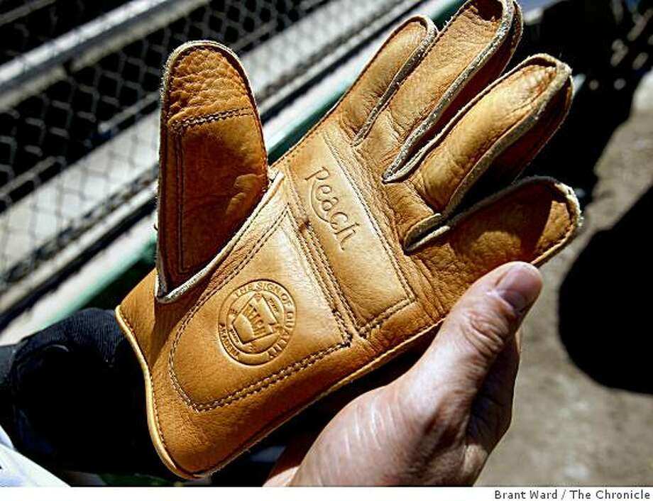 The players all use these period-correct gloves which have no webbing and are little bigger than garden gloves. Seven Bay Area baseball teams play the game the way it was played in 1886 complete with small gloves, large wooden bats and old style uniforms. The San Francisco Pacifics hosted the Fremont Aces at Golden Gate Park Sunday April 19, 2009. Photo: Brant Ward, The Chronicle