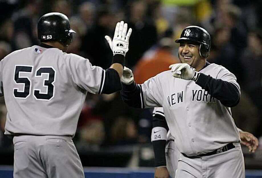 New York Yankees' Jose Molina, right, smiles as he is greeted by Melky Cabrera (53) after hitting a grand slam off of Detroit Tigers reliever Brandon Lyon in the seventh inning of a baseball game Tuesday, April 28, 2009 in Detroit. The Yankees scored 10 runs in the seventh inning. (AP Photo/Duane Burleson) Photo: Duane Burleson, AP