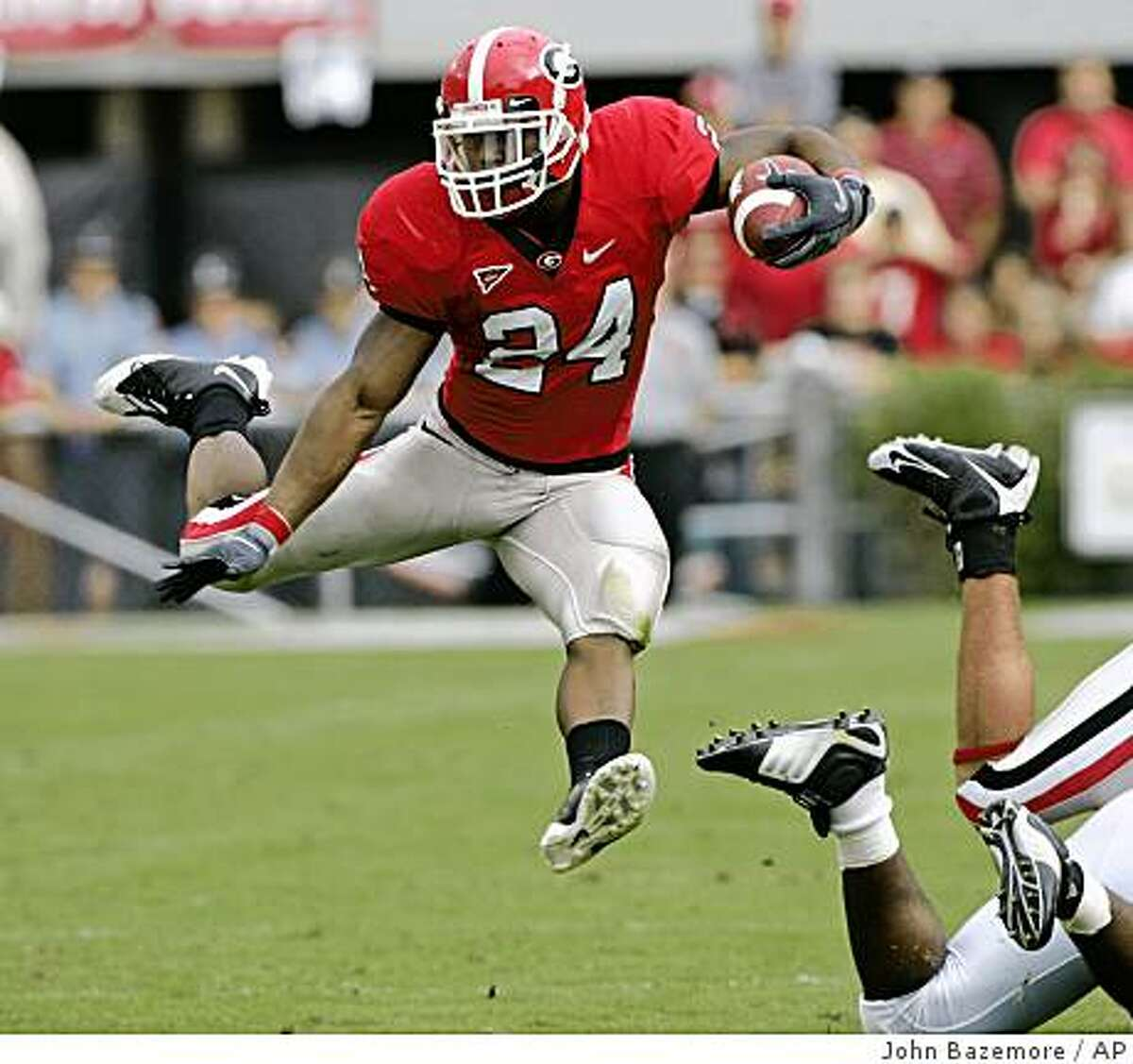 ** FOR USE AS DESIRED WITH NFL DRAFT STORIES ** FILE - In this Oct. 11, 2008 file photo, Georgia running back Knowshon Moreno leaps during a run in the first quarter of an NCAA college football game against Tennessee in Athens, Ga. Moreno is a top prospect in the 2009 NFL Draft.(AP Photo/John Bazemore, File)