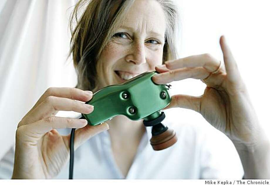 "Mary Roach, the author of ""Bonk: The Curious Coupling of Science and Sex."" shows off a vintage vibrator at Good Vibrations in San Francisco on Wednesday, April, 2, 2008 in San Francisco, Calif.  Photo by Mike Kepka / San Francisco Chronicle Photo: Mike Kepka, The Chronicle"