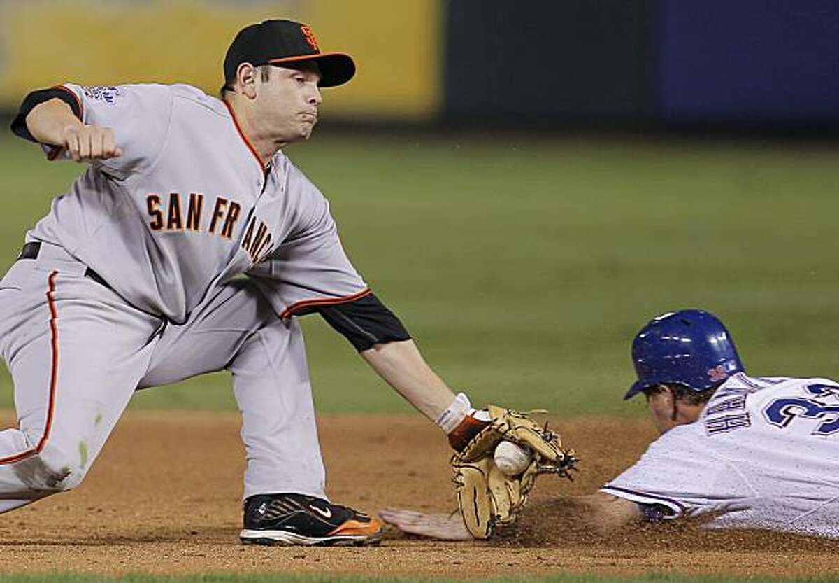 San Francisco Giants second baseman Freddy Sanchez gets the out on Texas Rangers left fielder Josh Hamilton to end the fourth inning of Game 4 of the World Series on Sunday.