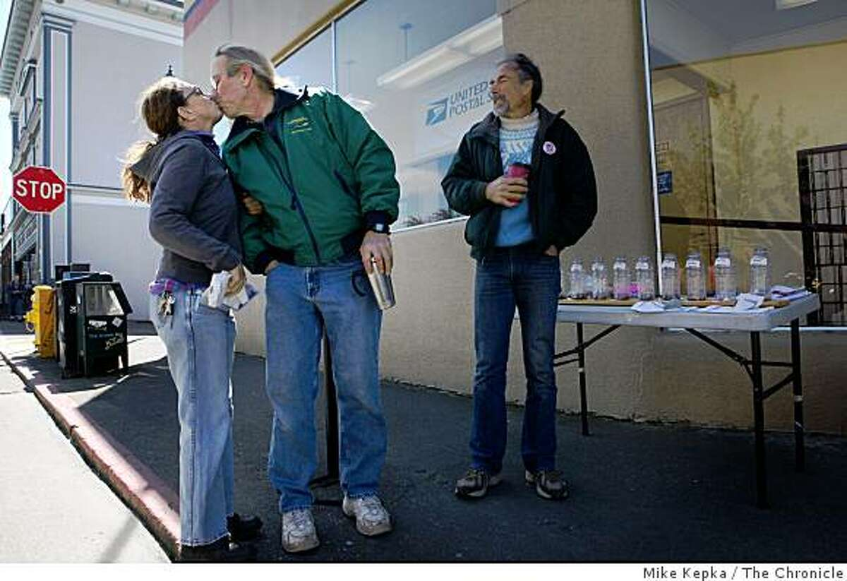 Dave Merserve, a building contractor who calls his activism a hobby, kisses his wife Betsy Roberts as she leaves him to continue his