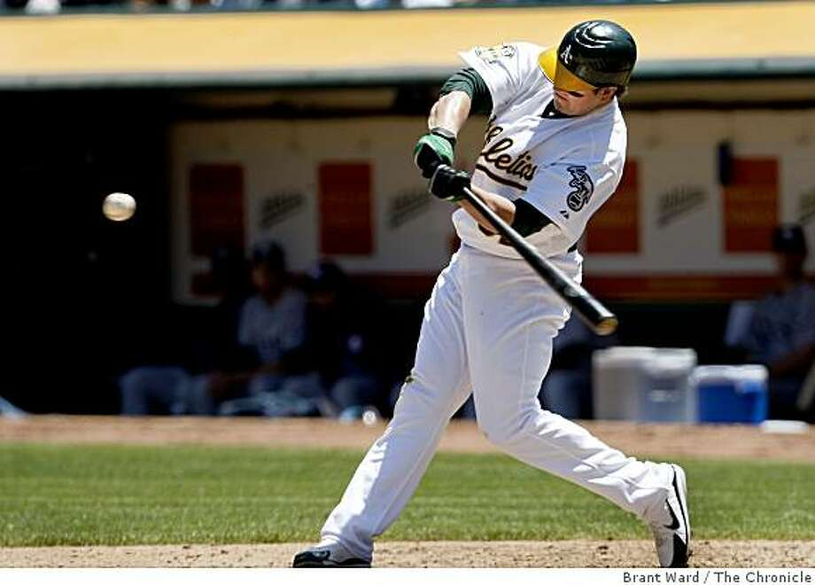 Jack Cust hits his first home run, with a runner on, in the 5th inning to make the score 6-0. The Oakland A's defeated the Tampa Bay Rays Wednesday, May 21, 2008 by a score of 9-1. Photo by Brant Ward / The Chronicle Photo: Brant Ward, The Chronicle