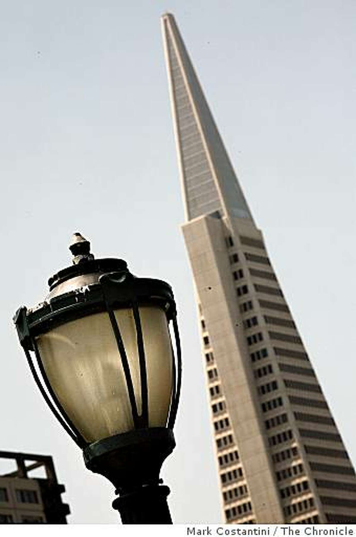 Detail of an old-style post lamp with the modern Transamerica Pyramid in the background�at Pier 7 in San Francisco, California on May 8, 2008. Photo by Mark Costantini / San Francisco Chronicle.