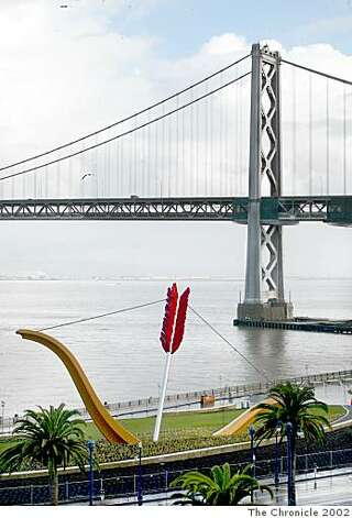 "The sculpture ""Cupid's Span"" on the embarcadero, with the Bay Bridge in the background. Photo: The Chronicle, 2002"