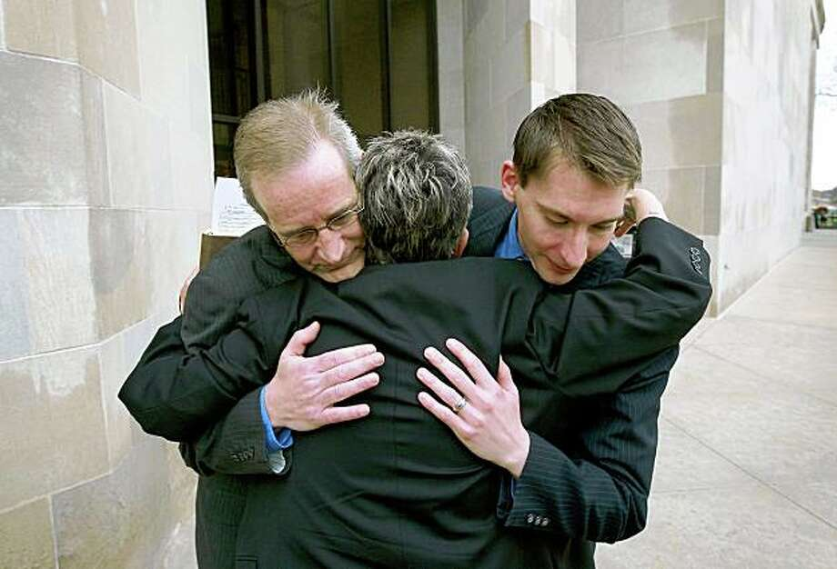 DES MOINES, IA - APRIL 27:  Gary Seronko (L) and his husband Curtis Rathmeier get a hug from Rev. Peg Esperanza following a brief wedding ceremony on the steps of the Polk County Administration Building April 27, 2009 in Des Moines, Iowa. Today was the first day gay couples were allowed to marry in the state following an April 3, 2009 ruling by the Iowa Supreme Court which declared a legislative ban on same-sex marriage unconstitutional.  (Photo by Scott Olson/Getty Images) Photo: Scott Olson, Getty Images