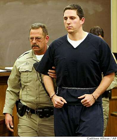 Johannes Mehserle, right, appears in the East Fork Justice Court on Wednesday, Jan. 14, 2009, in Minden, Nev. Mehserle is being held on charges related to the New Year's day shooting of an unarmed man on an Oakland, Calif., train platform. Mehserle, 27, waived extradition to California early Wednesday during a brief court appearance in Minden, Nev., and was being held without bail on a warrant charging homicide. Douglas County Sheriff's Deputy Ron Mills is at left. Photo: Cathleen Allison, AP