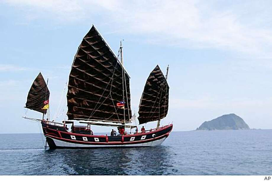 The Princess TaiPing sails off the coast of Taiwan. Eleven crew members of a 54-foot wooden Chinese junk were rescued after a freighter rammed into the replica vessel, splitting it in half off the coast of Taiwan, relatives of crew members from Hawaii said Monday, April 27, 2009. Photo: AP