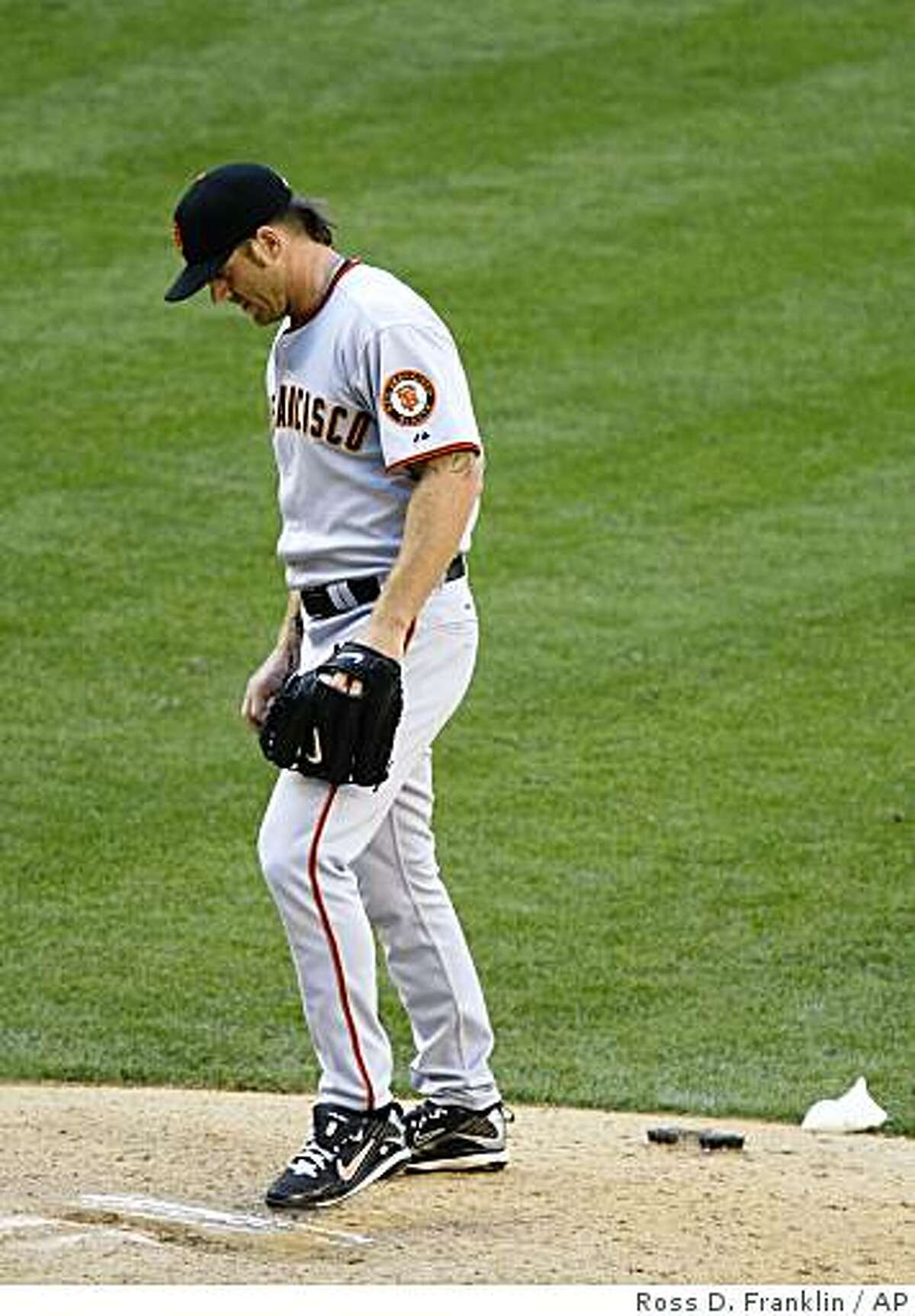 San Francisco Giants' Brian Wilson kicks the pitching rubber after giving up the game-tying home run to Arizona Diamondbacks' Justin Upton in the ninth inning of a baseball game Sunday, April 26, 2009, in Phoenix. (AP Photo/Ross D. Franklin)