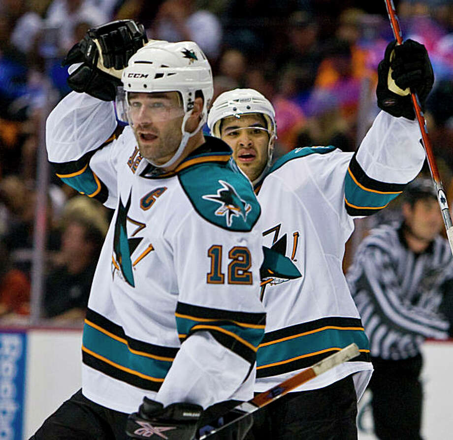San Jose Sharks center Patrick Marleau, left, and Devin Setoguchi, celebrate Marleau's game-winning goal against the Anaheim Ducks in the third period of a first-round NHL hockey playoff game in Anaheim, Calif., Tuesday, April 21, 2009. Sharks won 4-3. (AP Photo/Mark Avery) Photo: Mark Avery, AP / ONLINE_YES