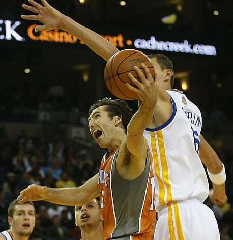 Golden State Warriors vs. Phoenix Suns.   Phoenix Suns guard Steve Nash shoots past Warriors Andris Biedrins during the first half of the game as the Phoenix Suns take the lead at the Oracle arena in Oakland, Calif., on Thursday, December 2, 2010. Photo: Liz Hafalia, The Chronicle