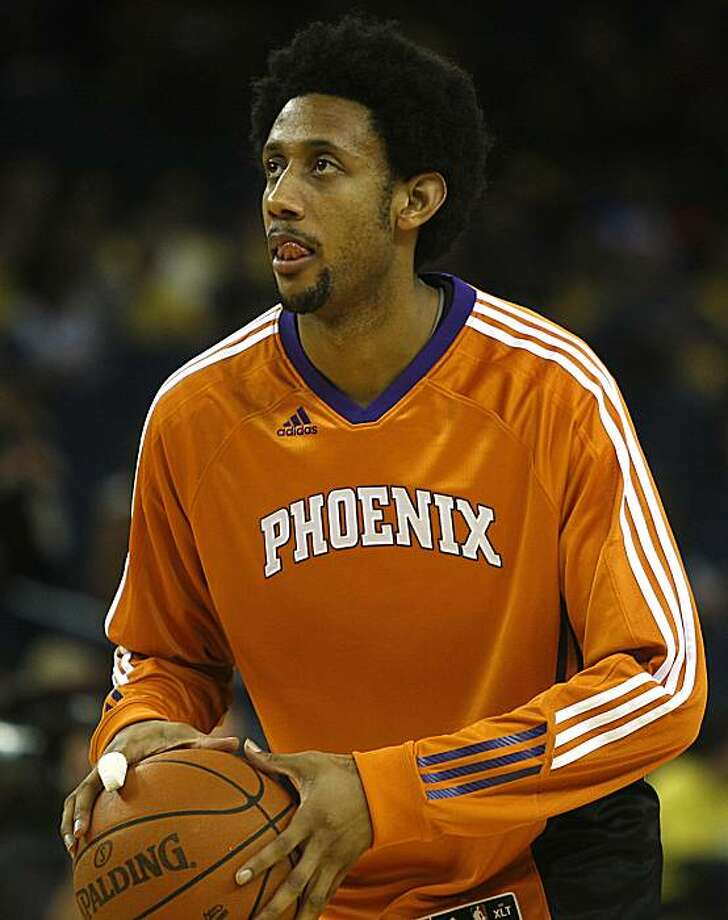 Phoenix Suns guard Josh Childress warms up with the team before the game as Golden State Warrriors vs. Phoenix Suns at the Oracle arena in Oakland, Calif., on Thursday, December 2, 2010. Photo: Liz Hafalia, The Chronicle