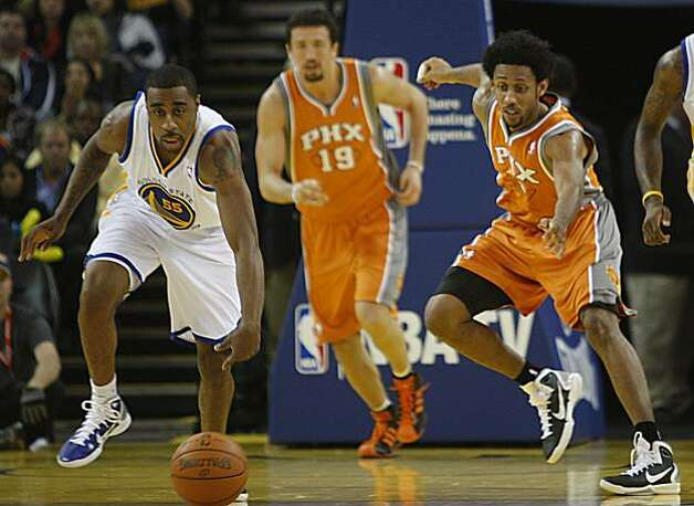 Warriors forward Reggie Williams (left) and Phoenix Suns guard Josh Childress (right) go for a loose ball during the second half of the game  as Golden State Warrriors vs. Phoenix Suns at the Oracle arena in Oakland, Calif., on Thursday, December 2, 2010. Photo: Liz Hafalia, The Chronicle