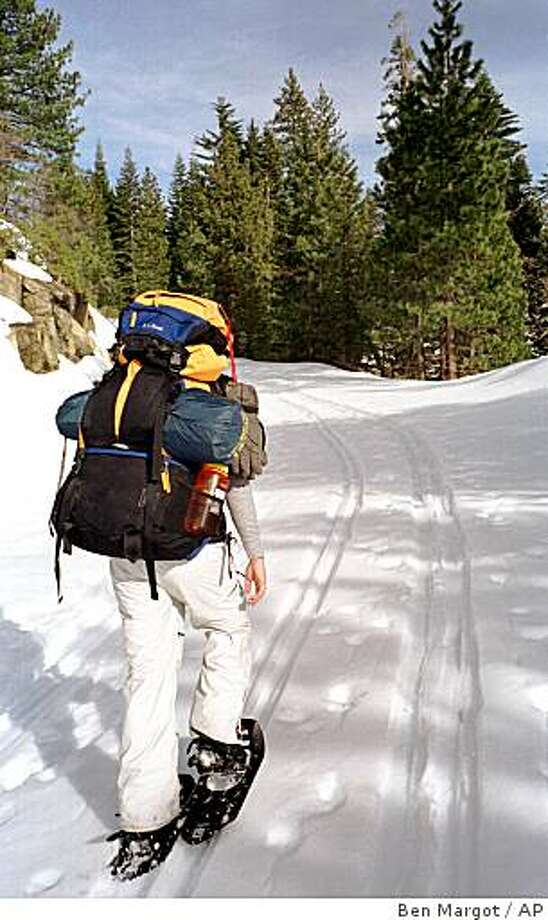 A snowshoe hike to Dewey Point yields spectacular views of Yosemite Valley, Photo: Ben Margot, AP