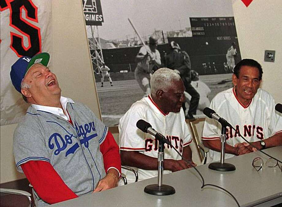 In 1997, ex-Dodger Gino Cimoli and ex-Giants Valmy Thomas and Ruben Gomez talked about the first West Coast major-league game. Photo: Eric Risberg, AP
