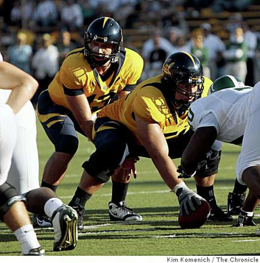 Cal quarterback Kevin Riley takes the snap from center Alex Mack in the second quarter as Cal plays Michigan State at Memorial Stadium in Berkeley Calif., on Saturday, Aug. 30, 2008. Photo: Kim Komenich, The Chronicle