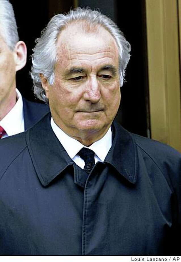 Bernard Madoff exits Manhattan federal court in New York on Tuesday, March 10, 2009. Madoff will plead guilty Thursday to 11 felony counts including money laundering, perjury and securities fraud that carry a potential prison term of 150 years, his lawyer and prosecutors said Tuesday. (AP Photo/Louis Lanzano) Photo: Louis Lanzano, AP