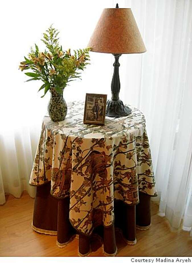 Madina Aryeh tops an inexpensive table draped in a tablecloth with favorite knick-knacks to dress up a room. Photo: Courtesy Madina Aryeh