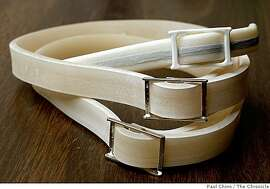 Flea collars for cats (top) and dogs (center and bottom) that contain the toxic chemicals Propoxur and Tetrachlorvinphos are displayed in San Francisco, Calif., on Thursday, April 23, 2009. An environmental group is filing a lawsuit against several manufacturers and retailers of the collars claiming they are violating voter-approved Proposition 65.