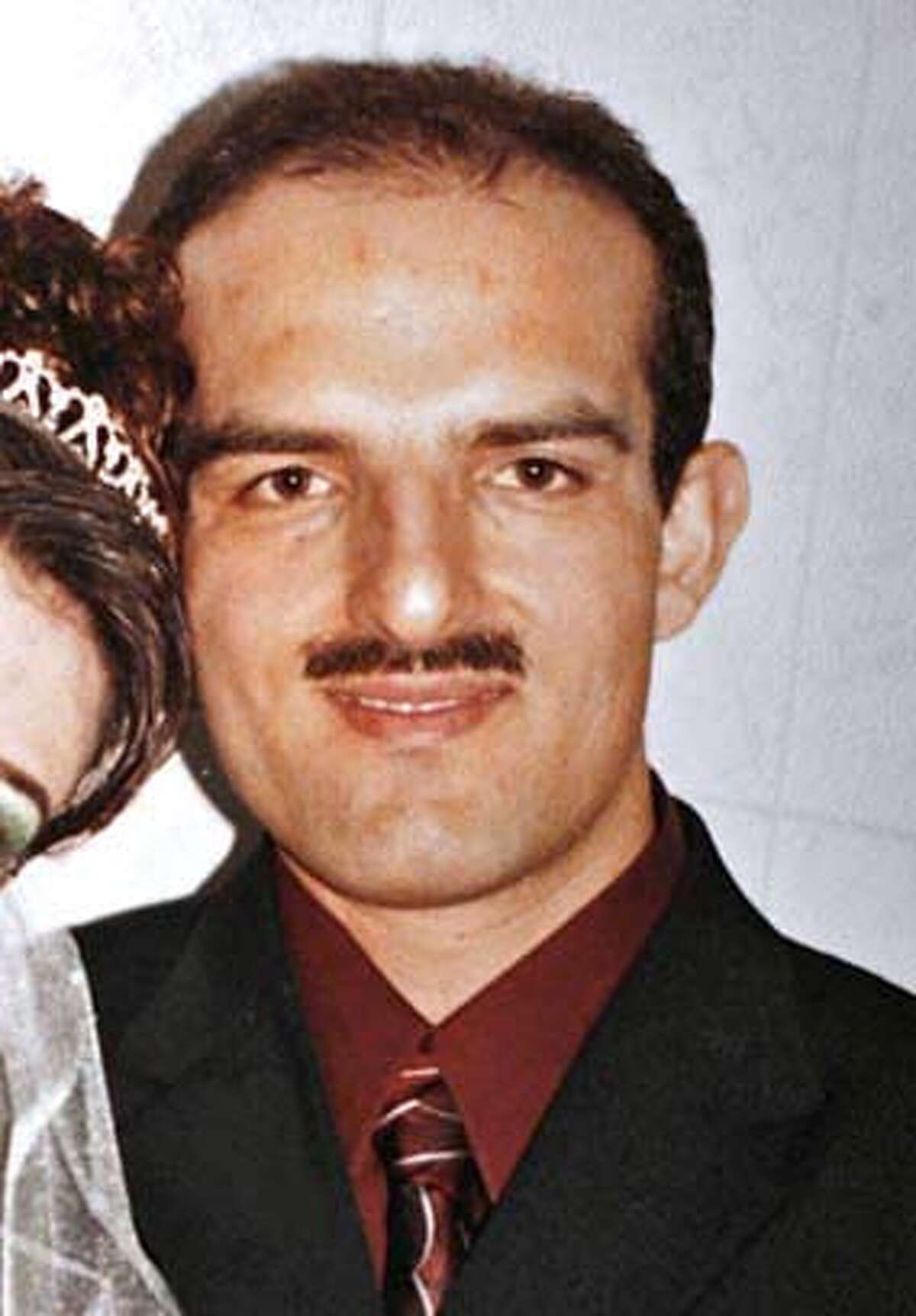 hitandrun_266_mac.jpg Wedding photo believed to be about two weeks old, showing Omeer with his new bride Nahid, taken in Afghanistan. Hit and run victims in the Fremont area as well as San Francisco, 13 victims in all, one confirmed fatality in Fremont. Suspect Omeed Aziz Bopal of Fremont Event in, Fremont, Ca, on 8/29/06. Hand Out Photo Mandatory credit for Photographer and San Francisco Chronicle / Magazines Out