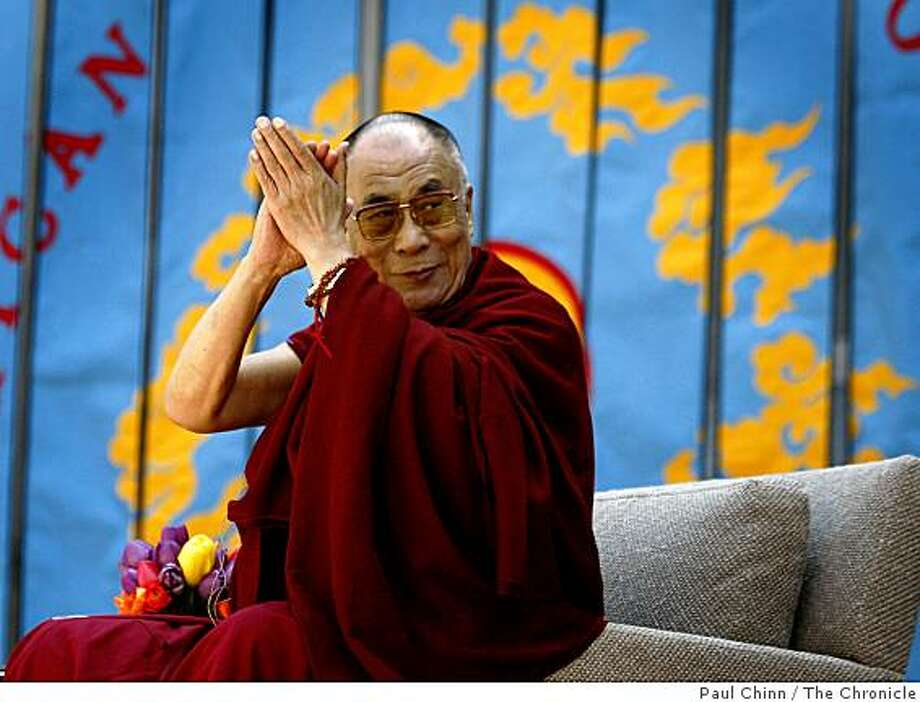 """The Dalai Lama applauds during a series of speeches before his own about """"Peace Through Compassion"""" at the Greek Theatre in Berkeley, Calif., on Saturday, April 25, 2009. Photo: Paul Chinn, The Chronicle"""