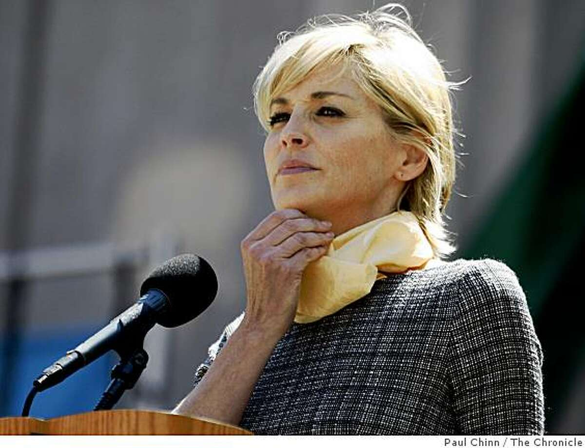Actress Sharon Stone, a personal friend of the Dalai Lama, delivers thoughtful remarks before the exiled spiritual leader of Tibet spoke about