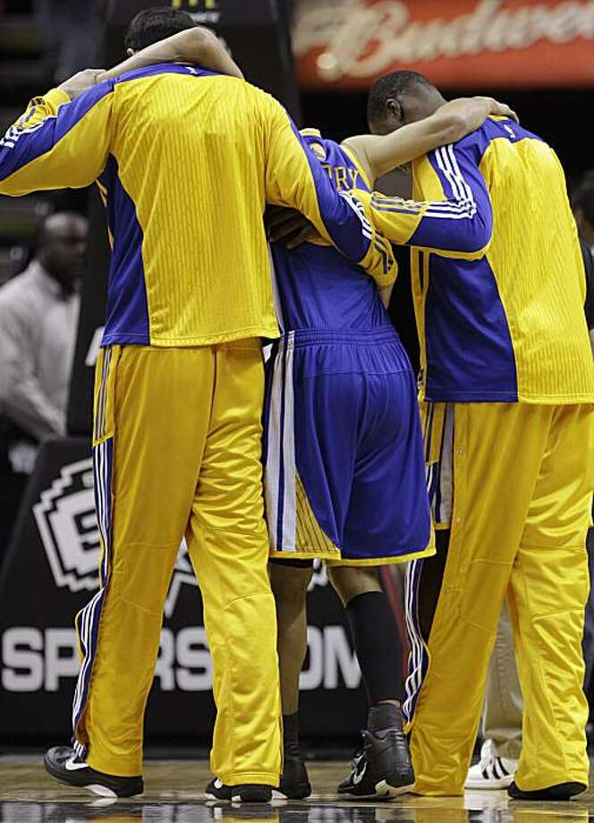 Golden State Warriors' Stephen Curry, center, is helped off the court after he was injured during the first quarter of an NBA basketball game against the San Antonio Spurs, Wednesday, Dec. 8, 2010, in San Antonio. Photo: Eric Gay, AP