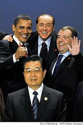 FOR INSIGHTG20 leaders Chinese President Hu Jintao  (first row), (2nd row from L to R) US President Barack Obama, Italian Prime Minister Silvio Berlusconi and Russian President Dmitry Medvedev pose for a family photo during the G20 summit at the ExCel centre, in east London, on April 2, 2009. World leaders meet Thursday for a crunch summit of the Group of 20 richest nations aimed at fixing the crisis-wracked global economy. AFP PHOTO/Eric Feferberg (Photo credit should read ERIC FEFERBERG/AFP/Getty Images)