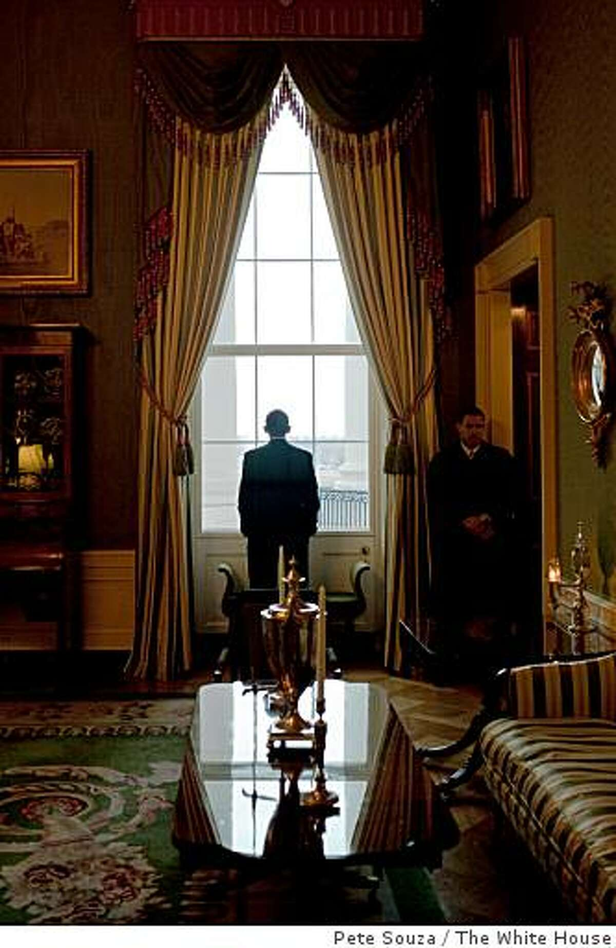 President Barack Obama looks out the Green Room window prior to the