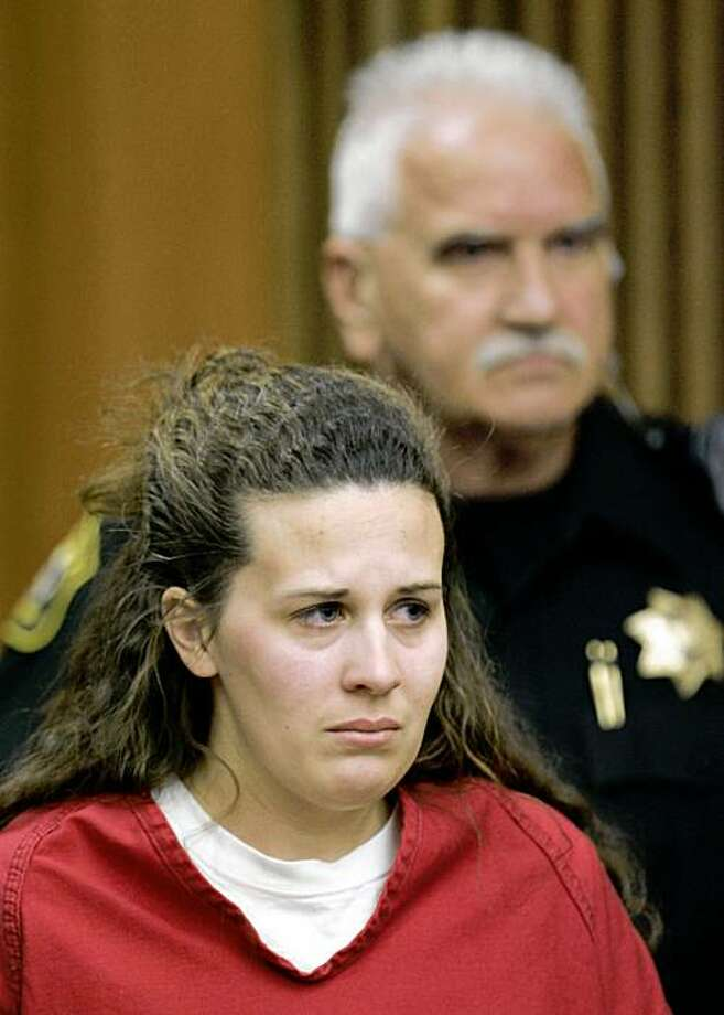 Melissa Huckaby, 28, listens in a Stockton, Calif., courtroom during her arraignment, Tuesday, April 14, 2009.  Huckaby was charged with murdering her daughter's friend, 8-year-old Sandra Cantu, in a gruesome crime that has shocked and terrified residents in Tracy, a city of about 78,000 people, 60 miles east of San Francisco. (AP Photo/Paul Sakuma, Pool) Photo: Paul Sakuma, AP