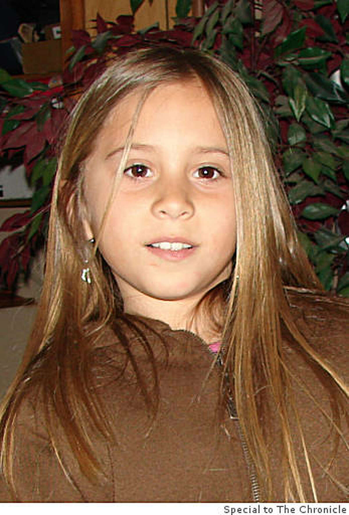 This hanout photo of 8 year old Sandra Cantu of Tracy, Califorina, was taken on March 8, 2009 on her 8th birthday. Cantu was reported last being seen on March 27 at Orchard Estates Mobile Home Park wearing a pink Hello Kitty shirt and a striped dress. She is hispanic, with brown hair, brown eyes, about 4 feet tall and weighs 45 pounds.