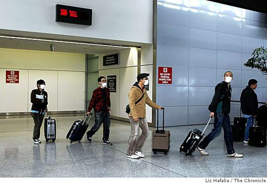 At the arrival gate of San Francisco International airport as passengers come from customs on Monday, April 27, 2009. Photo: Liz Hafalia, The Chronicle