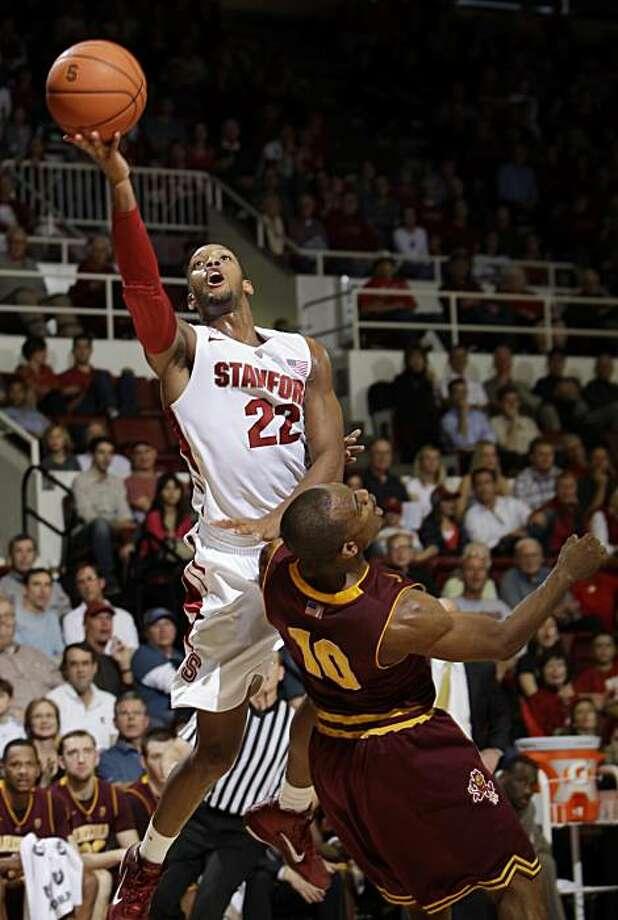 Stanford Cardinal guard Jarrett Mann (22) scores over Arizona State guard Jamelle McMillan (10) in the first half of an NCAA college basketball game in Stanford, Calif., Saturday, Feb. 5, 2011. Photo: Paul Sakuma, AP